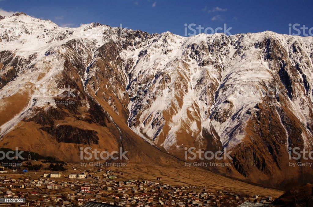 View on Stepantsminda (former Kazbegi) town stock photo