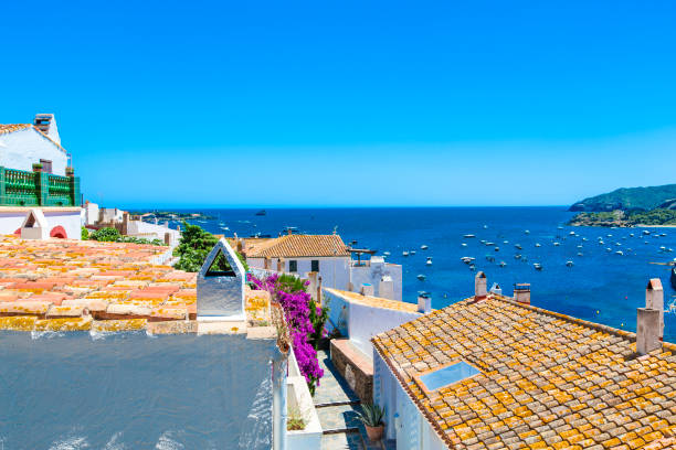 view on street in cadaques, catalonia, spain near of barcelona. scenic old town with nice beach and clear blue water in bay. famous tourist destination in costa brava with salvador dali landmark - moldova stock pictures, royalty-free photos & images