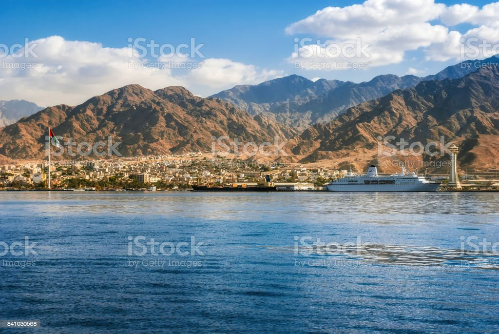 View on the Aqaba waterfront and Aqaba sea port, Jordan from the Red sea stock photo