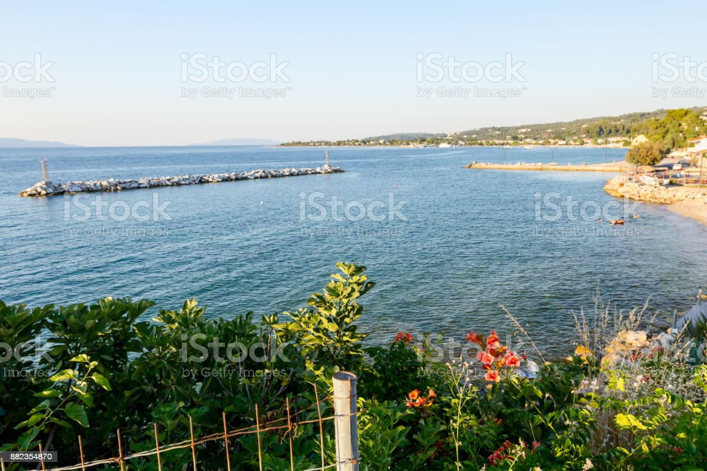 View on the bay with artificial reef, walled seashore against water erosion stock photo