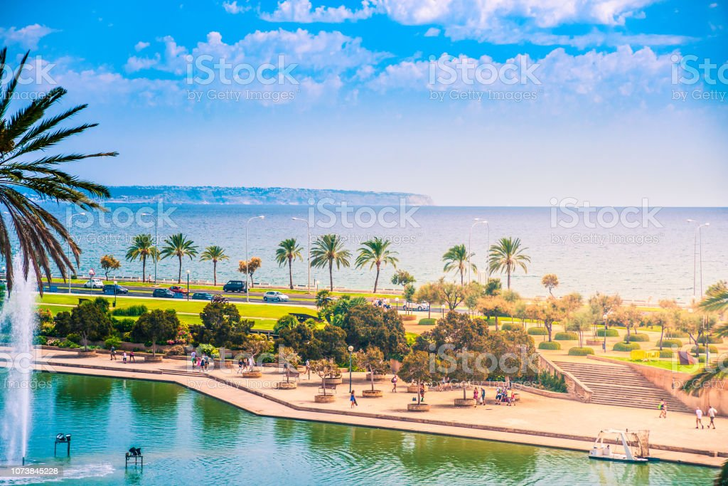 View on the beach of Plama de Mallorca with palm trees stock photo