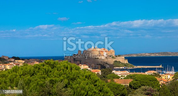Panorama view of citadel with houses in Calvi bay, Corsica island, France. Beautiful travel picture of famous tourist destination. France