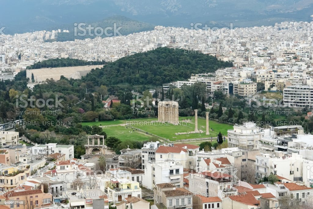 View on the city of Athens and the ruins of the Temple of Olympian Zeus. stock photo