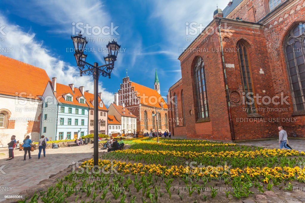 View on the colored cozy old houses and church that are located in the city center of Riga.Latvia. - Royalty-free Architecture Stock Photo