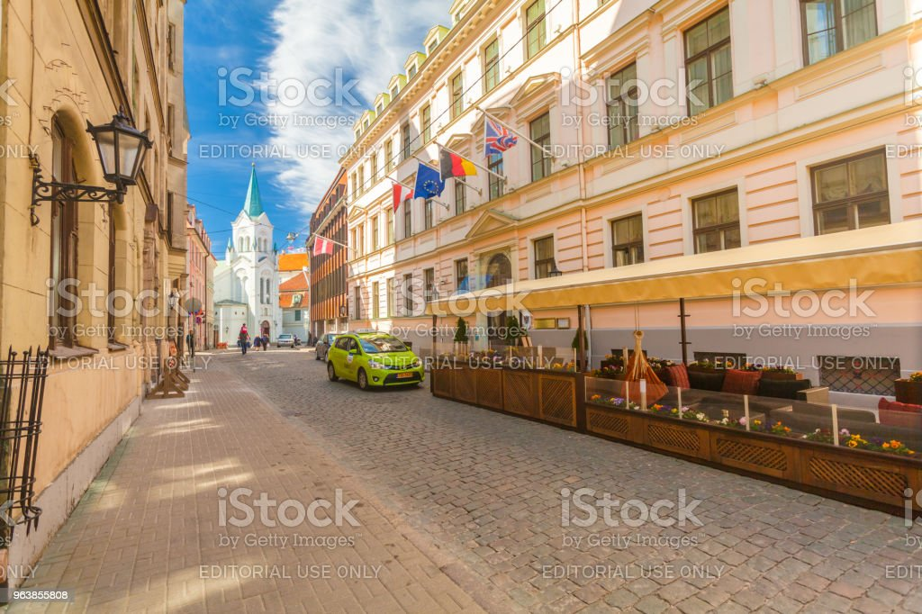 View on the colored cozy old houses, church and that are located in the city center of Riga. Latvia. - Royalty-free Architecture Stock Photo