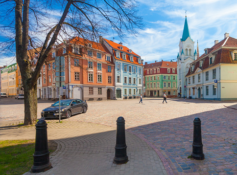 View On The Colored Cozy Old Houses Churchsouvenir Street Shops And Tourists That Are Located In The City Center Of Riga Latvia Stock Photo - Download Image Now