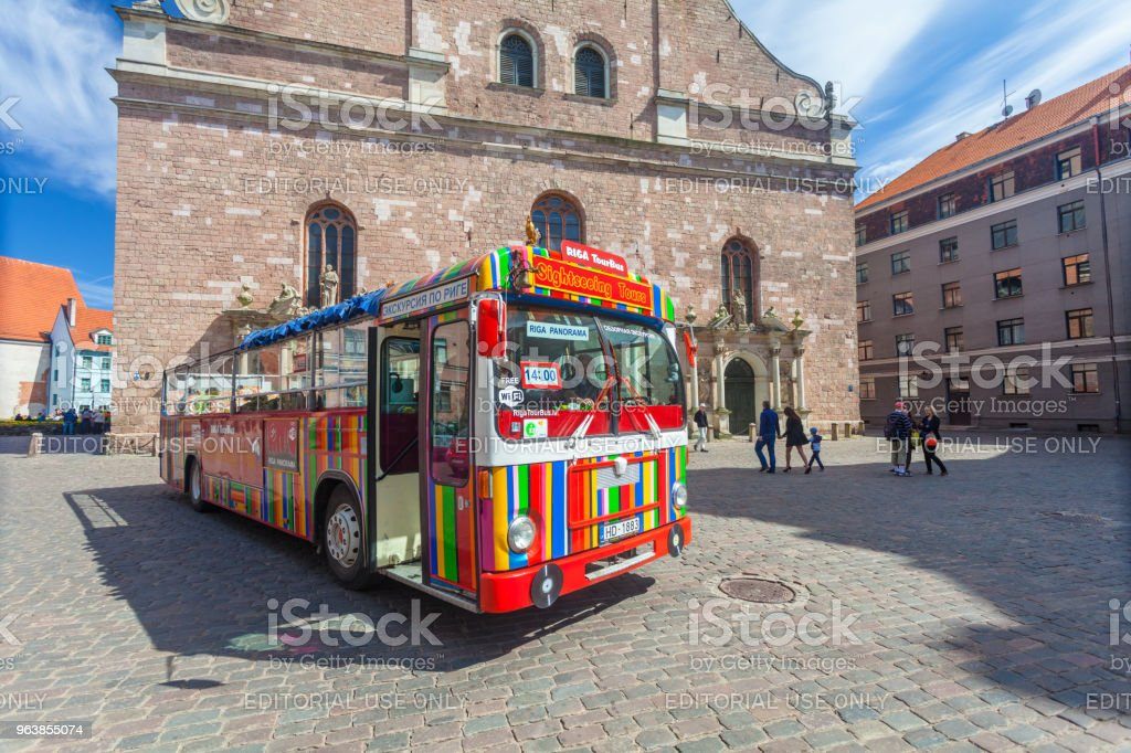 View on the colored tourist bus for hop on/hop off tour that is located in the city center of Riga.Latvia. - Royalty-free Architecture Stock Photo