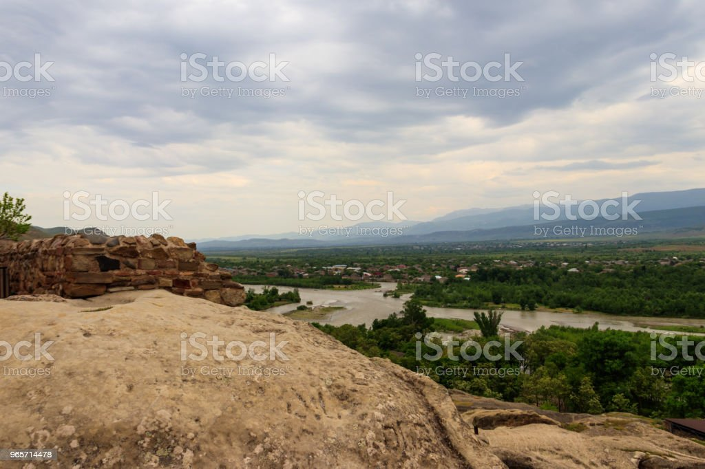 View on the Kura river and Caucasus mountains from Ancient cave city Uplistsikhe, Georgia - Royalty-free Aerial View Stock Photo