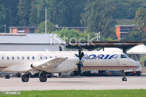 Agno, Ticino, Switzerland - 6th October 2019 : View on the Lugano-Agno airport with a parked air Adria Airplane located in the Canton of Ticino, Switzerland