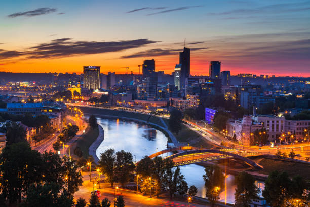 VILNIUS, LITHUANIA - 21 AUG 2015. View on the night business city of Vilnius and river stock photo