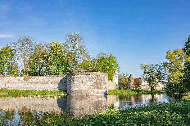 view on the old city wall in maastricht - maastricht stockfoto's en -beelden