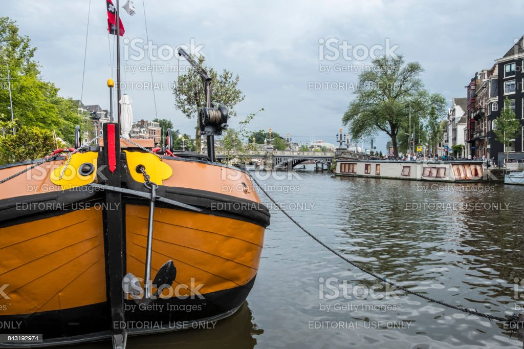 View on the river Amstel in Amsterdam with house boats stock photo