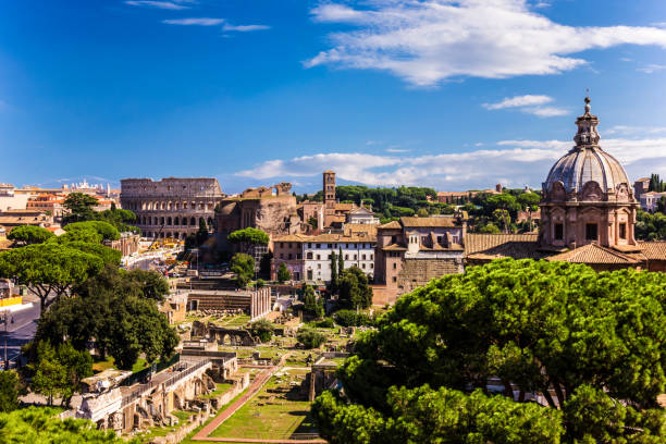 View on the Santi Luca e Martina and  Colosseum from Vittoriano View on the Santi Luca e Martina and  Colosseum from Vittoriano lazio stock pictures, royalty-free photos & images