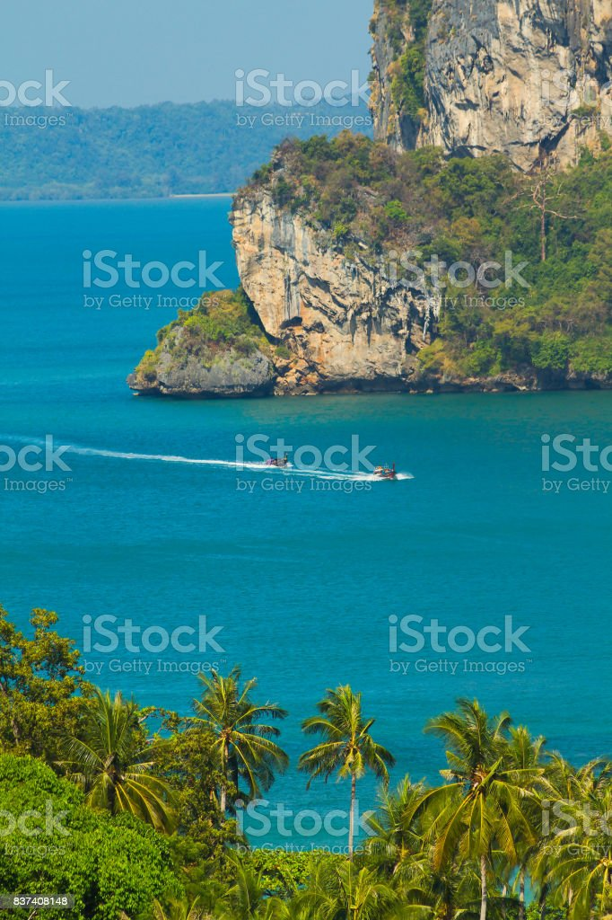 View on the sea and palm trees in Thailand stock photo