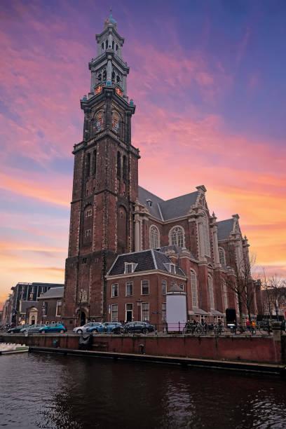 view on the westerkerk in amsterdam the netherlands - westerkerk stockfoto's en -beelden