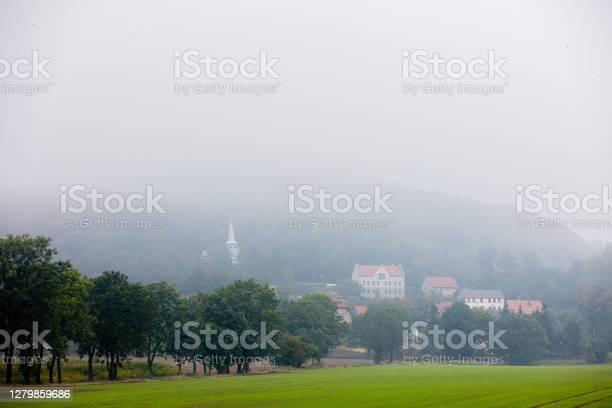 Photo of View on village in a fog in Lower Silesia, South Poland