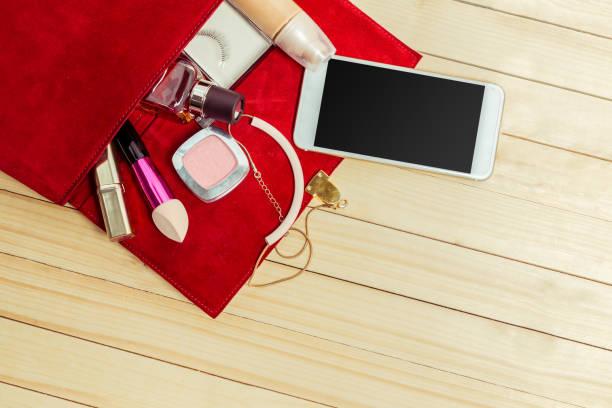 view on women bag stuff on wooden background - oggetti personali foto e immagini stock