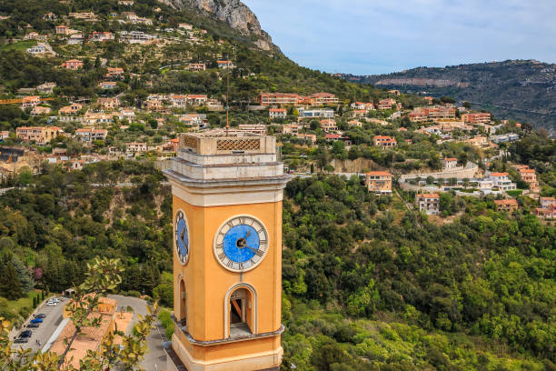 View onto an old church tower and hillside villages in the Alpes in Eze village on the French Riviera, South of France stock photo