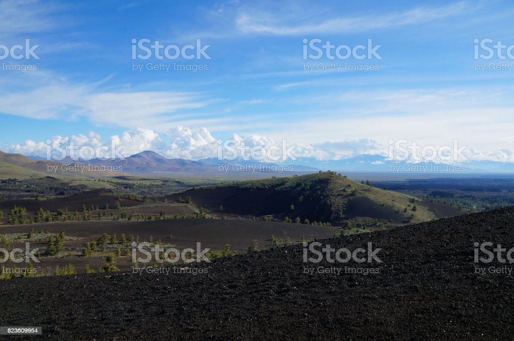 View over a black volcanic lava landscape from the Inferno Cone stock photo