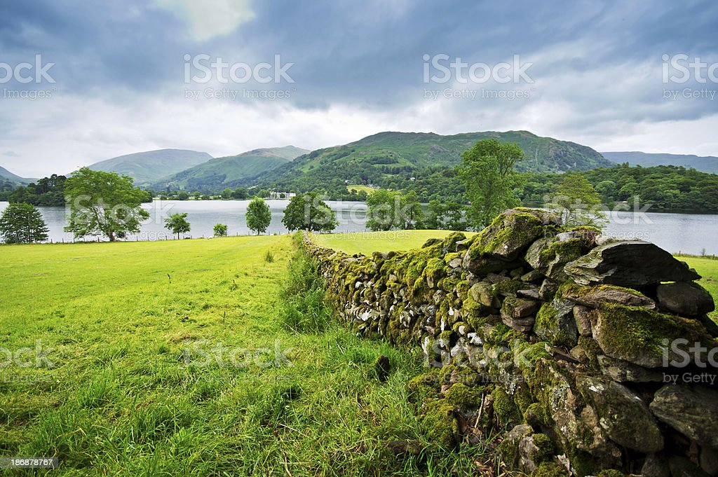 View over a dry stone wall in Cumbria stock photo