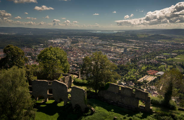 View over Hohentwil Castle and Singen (City) Singen am Hohentwiel, Germany - August 22, 2016: The image shows the city of Singen, a famous castle named Burg Hohentwil and lake Constance. singen stock pictures, royalty-free photos & images