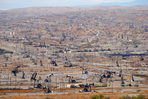 View over oil field in Bakersfiled, California, with derricks pumps. stock photo