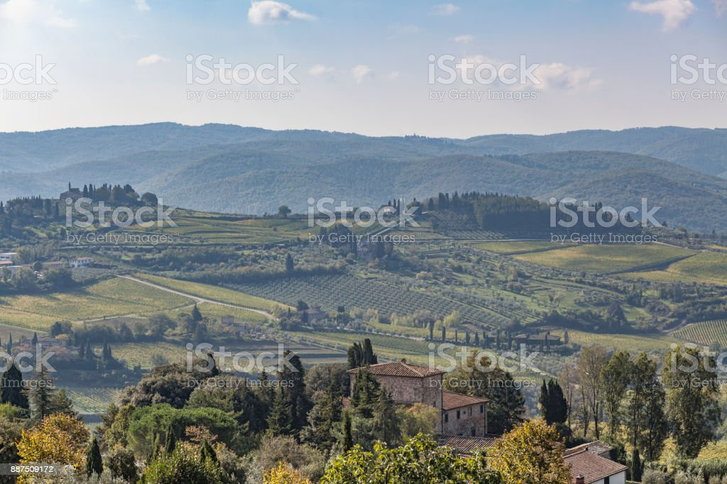 View over old stone house to hills with vineyards near Chastellina in Chianti in Tuscany stock photo