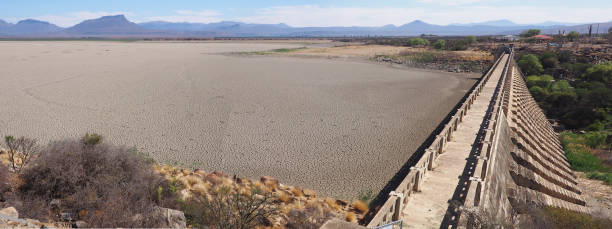 View over parched and empty dam wall stock photo