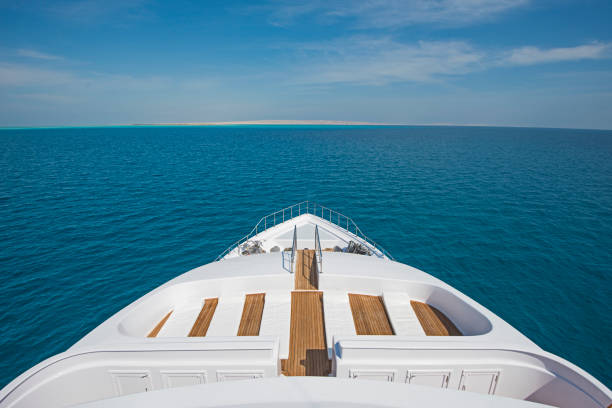 View over the bow over a large luxury motor yacht stock photo