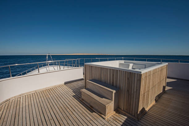 View over the bow over a large motor yacht with hot tub stock photo