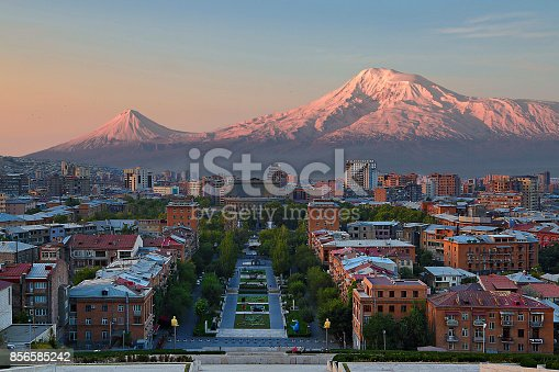 istock View over the city of Yerevan, capital of Armenia, with the two peaks of the Mount Ararat in the background, at the sunrise. 856585242