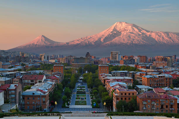 View over the city of Yerevan, capital of Armenia, with the two peaks of the Mount Ararat in the background, at the sunrise. stock photo