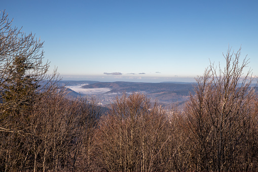 View over the Moselle valley in the fog from the Alsace Belchen