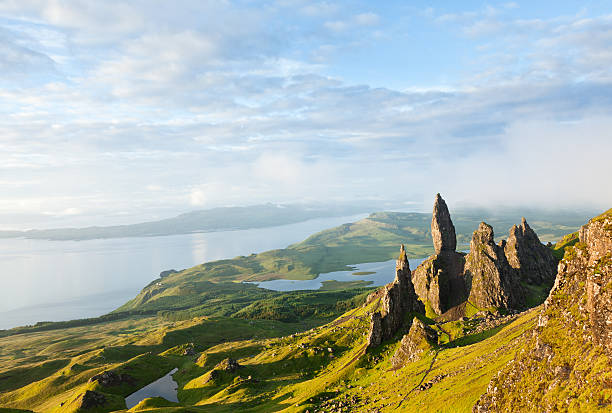 View over the Old Man of Storr The Storr is a rocky hill on the Trotternish peninsula of the Isle of Skye. The hill presents a steep rocky eastern face overlooking the Sound of Raasay, contrasting with gentler grassy slopes to the west.Overcast day.Picture taken at dawn, first light of the day. isle of skye stock pictures, royalty-free photos & images