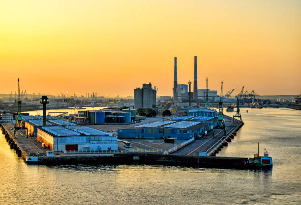View over the port of Le Havre in France at sunrise View over the port of Le Havre in France at sunrise le havre stock pictures, royalty-free photos & images