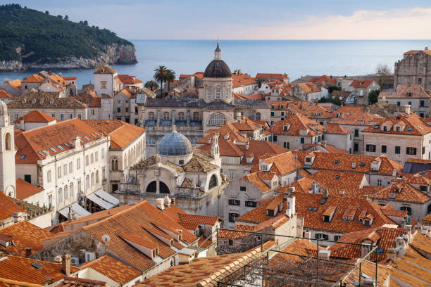 View over the roofs of old town Dubrovnik with church towers, ocean and island, Croatia stock photo