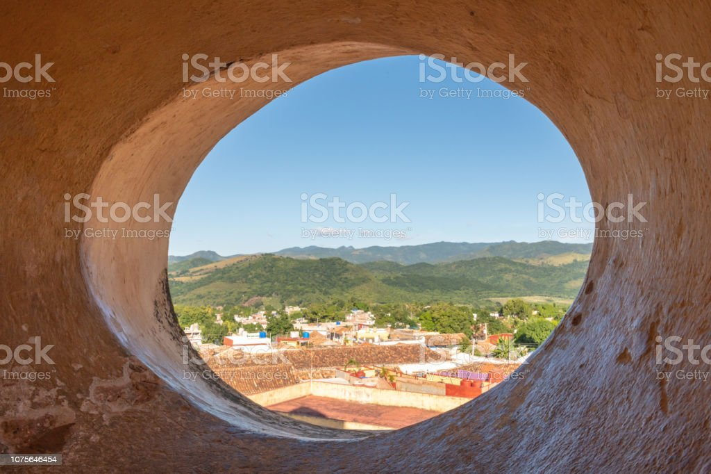 View over Trinidad, Cuba from a curved window stock photo