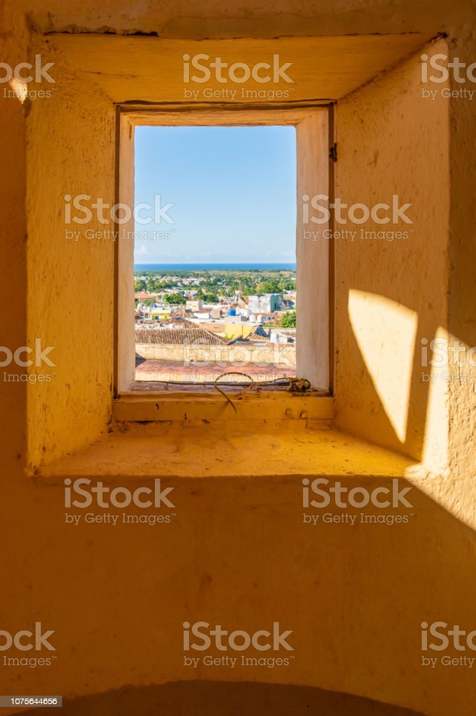 View over Trinidad, Cuba from a small window stock photo