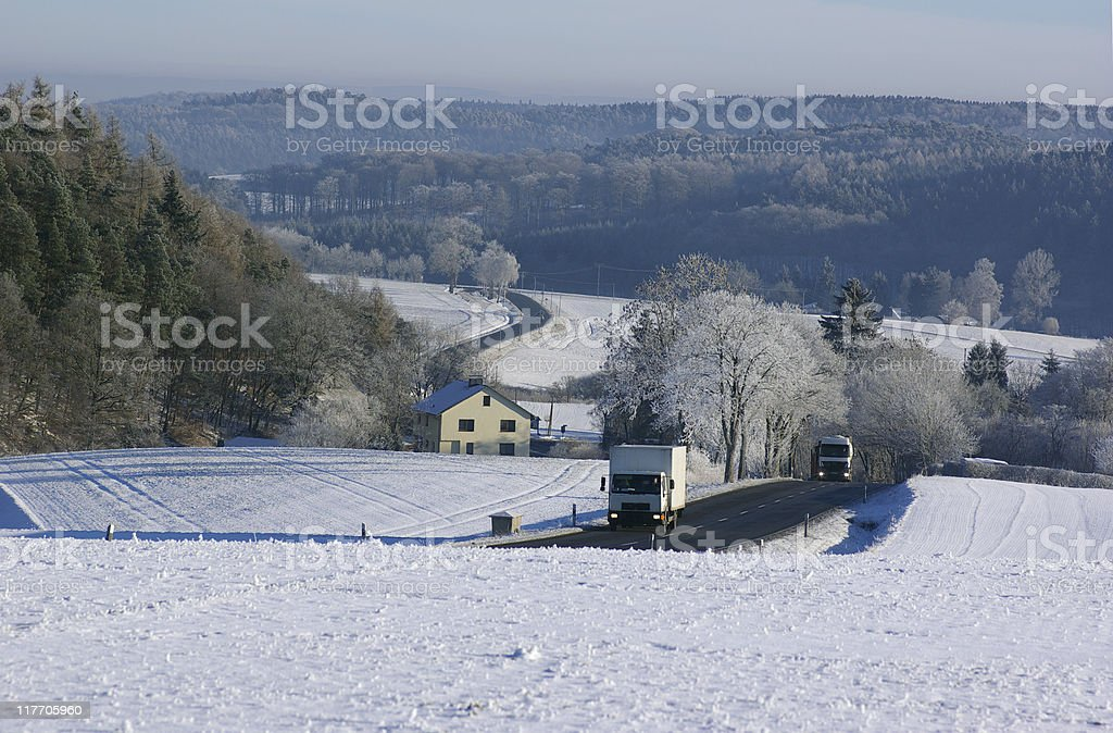 View over wintry landscape with Federal road and lorries royalty-free stock photo