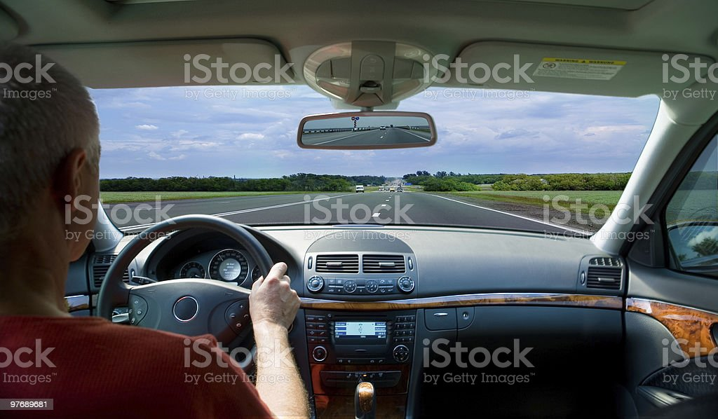View past driver's shoulder through windscreen of car royalty-free stock photo