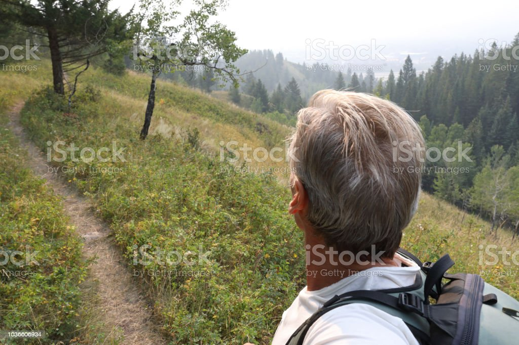 View Past Mans Upper Torso To Trail Ahead Stock Photo