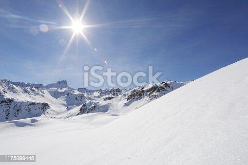 Sun beams in blue sky