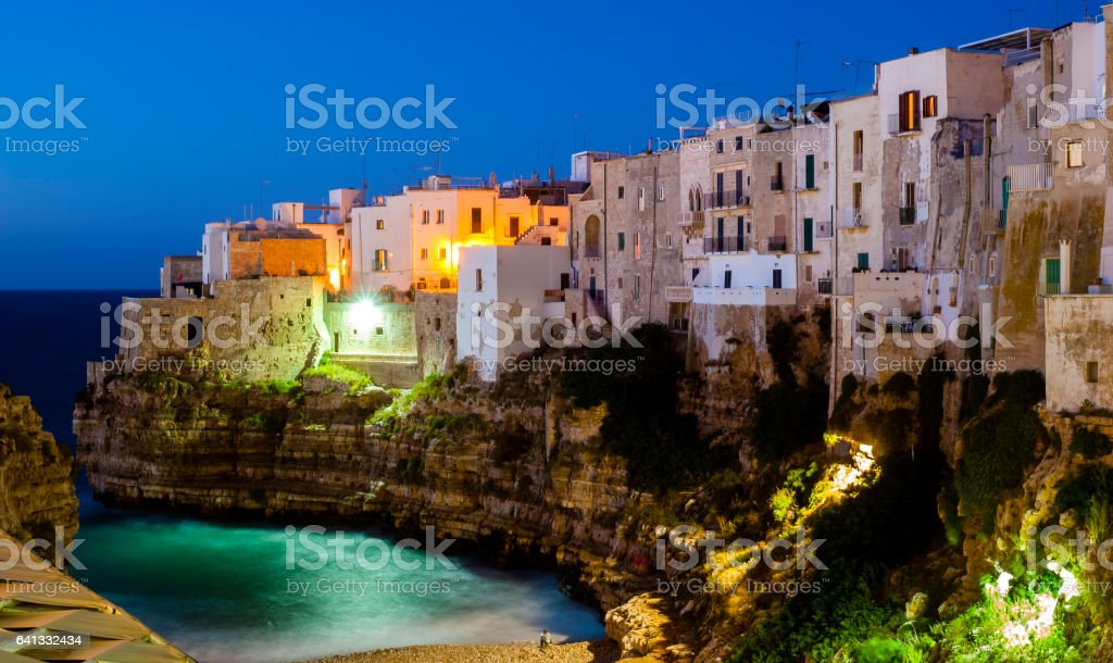 View Polignano a Mare at night. Sea and rocks. stock photo