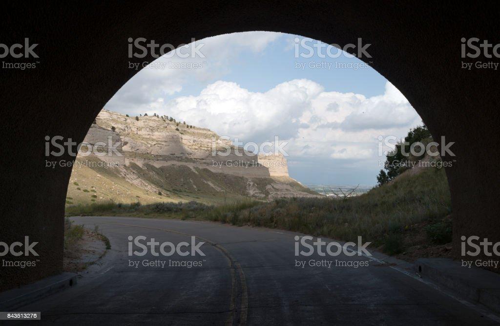 View Road Through Tunnell Scotts Bluff Nebraska stock photo