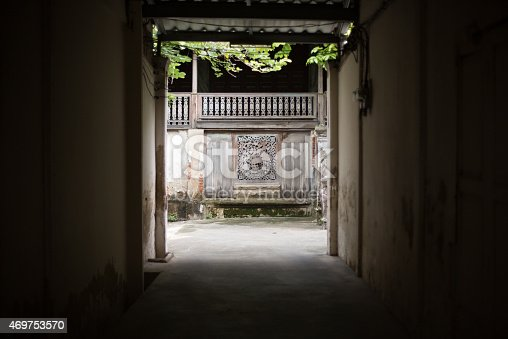 istock View through a dark alleyway into brightly-lit courtyard, Bangkok 469753570