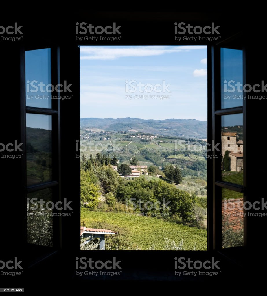 View through a window to the vineyards  in Tuscany in Italy stock photo