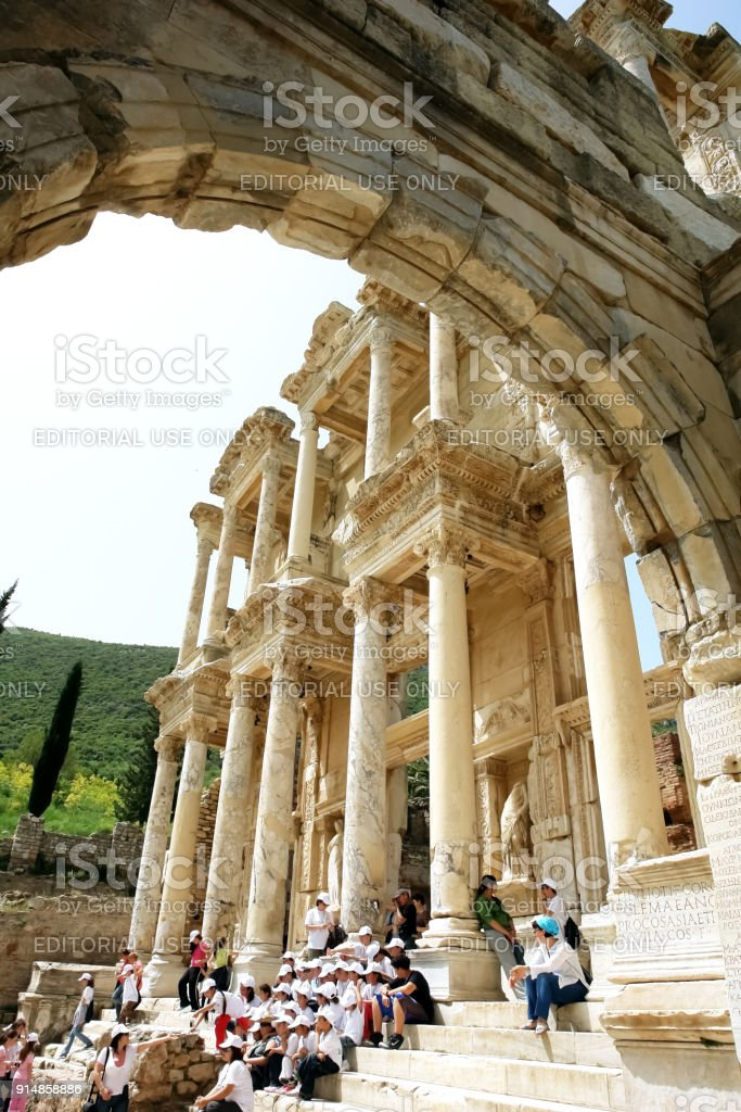 View through an old arch to the ruins of the ancient Roman library of Celsus in the ancient city of Ephesus. stock photo