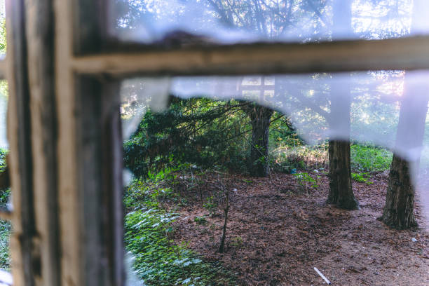 View through an old destroyed window stock photo