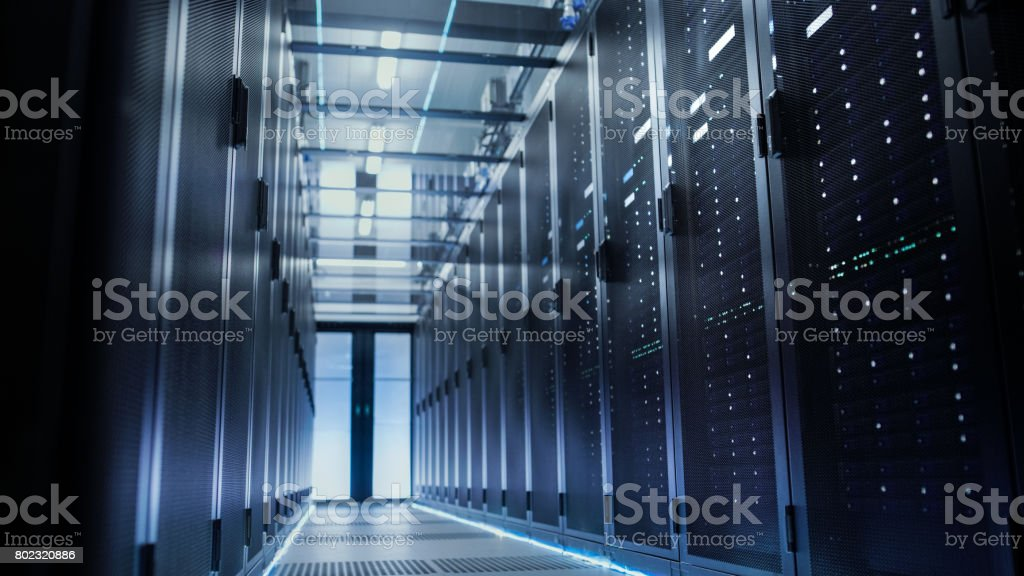 View Through Big Working Data Center with Server Racks. stock photo