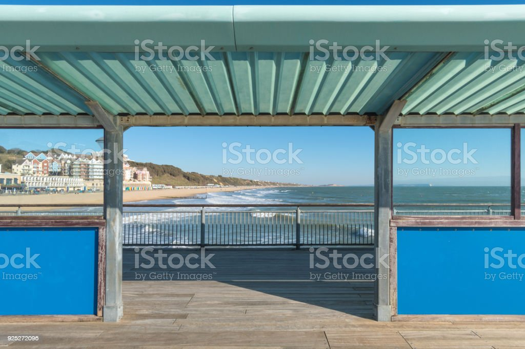 View through Boscombe Pier along Bournemouth Beach stock photo
